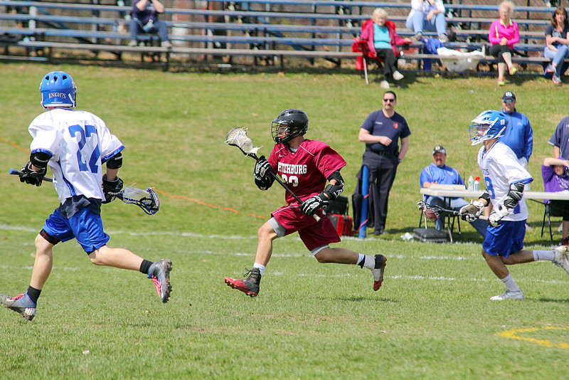 Fitchburg High School boy's lacrosse played Lunenberug High School on Tuesday April 22, 2014 at LHS. FHS's Alex Marrero takes off down field with the ball during action in the game. SENTINEL & ENTERPRISE/JOHN LOVE
