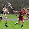 Fitchburg High's Shania Therrien reaches out to try and stop St. Bernard's Emma Trainor during action in the game. SENTINEL & ENTERPRISE/JOHN LOVE