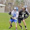 St. Bernard's High School played Lunenburg High School on Wednesday afternoon in Lunenburg. St. B's Liam O'Brien tries to stop LHS's Dustin Powell during action in the game. SENTINEL & ENTERPRISE/JOHN LOVE