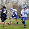St. Bernard's High School played Lunenburg High School on Wednesday afternoon in Lunenburg.  St. B's Zach Bingham get the ball by LHS's goalie Max Corbett for an early goal in the game.  A second to late to stop him was  LHS's Daniel Szabady. SENTINEL & ENTERPRISE/JOHN LOVE