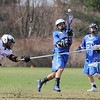 Leominster High School boys lacrosse played Fitchburg High School on Thursday afternoon at Nikitas Field in Fitchburg. FHS's Bruee Johnson tries to stop a shot on goal by Kenny Delgado during action in the game. SENTINEL & ENTERPRISE/JOHN LOVE