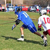 Leominster High School boys lacrosse played Fitchburg High School on Thursday afternoon at Nikitas Field in Fitchburg. LHS's Matt Richard pics up the ball followed close behind by FHS's Brett Bouanger. SENTINEL & ENTERPRISE/JOHN LOVE