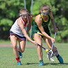 North Middlesex Regional High School girls Lacrosse played Tantasqua at home during the Central/Western Mass. Division 1 first round of playoffs. NMRHS player Danielle Kozloski fights for control of the ball with a THS player. SENTINEL & ENTERPRISE/JOHN LOVE