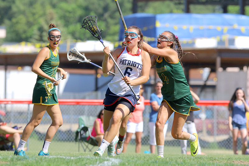 North Middlesex Regional High School girls Lacrosse played Tantasqua at home during the Central/Western Mass. Division 1 first round of playoffs. THS player Kelly Austin tries to stop NMRHS player Gianna D'Ambrosio during action in the game. SENTINEL & ENTERPRISE/JOHN LOVE