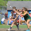 North Middlesex Regional High School girls Lacrosse played Tantasqua at home during the Central/Western Mass. Division 1 first round of playoffs.  NMRHS player Molly O'Neill tries not to loose the ball while tring to get by THS player Emma Jacque.SENTINEL & ENTERPRISE/JOHN LOVE