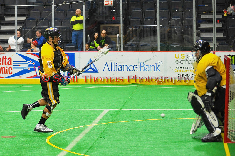 Syracuse Stingers Pete Jacobs (6) gets in alone for a shot on the NYC Lax All-Stars netminder Ross Bucktooth at the Onondaga County War Memorial in Syracuse, New York on Thursday, February 21, 2013.