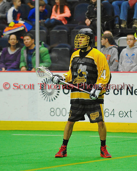 """Syracuse Stingers Tyler """"Silverfoot"""" Hill (14) on the field against the NYC Lax All-Stars at the Onondaga County War Memorial in Syracuse, New York on Thursday, February 21, 2013."""