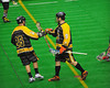 Syracuse Stingers players Wade Bucktooth (26) and Brandon Francis (9) celebrate a goal against the NYC Lax All-Stars at the Onondaga County War Memorial in Syracuse, New York on Thursday, February 21, 2013.