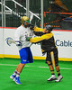Syracuse Stingers Kevin Wilkerson (8) checks a NYC Lax All-Stars opponent at the Onondaga County War Memorial in Syracuse, New York on Thursday, February 21, 2013.