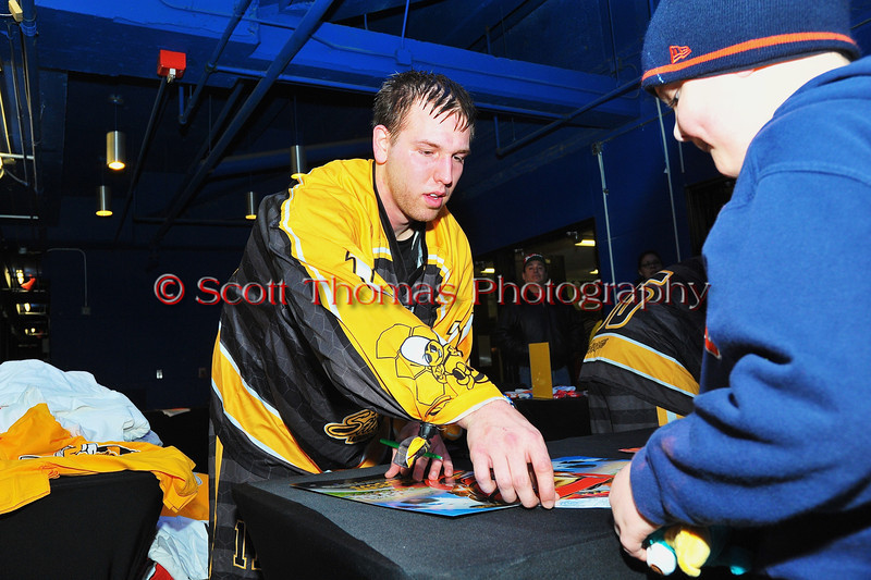 Syracuse Stingers Kyle Denhoff signing his autograph after playing the NYC Lax All-Stars at the Onondaga County War Memorial in Syracuse, New York on Thursday, February 21, 2013.
