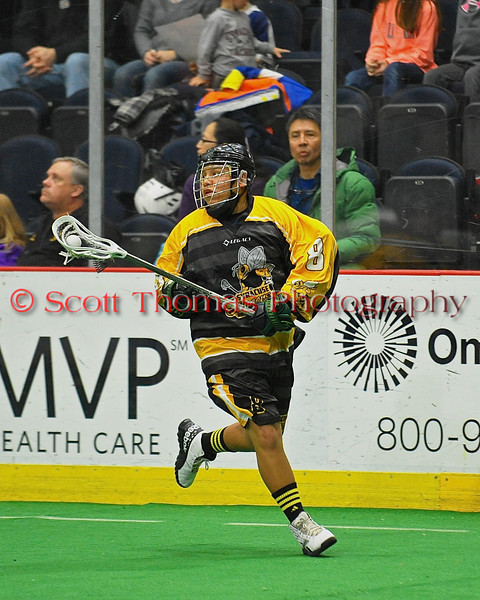 Syracuse Stingers Kevin Wilkerson (8) with the ball against the NYC Lax All-Stars at the Onondaga County War Memorial in Syracuse, New York on Thursday, February 21, 2013.