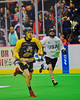 Syracuse Stingers Tyler Hill (14) with the ball against the NYC Lax All-Stars at the Onondaga County War Memorial in Syracuse, New York on Thursday, February 21, 2013.