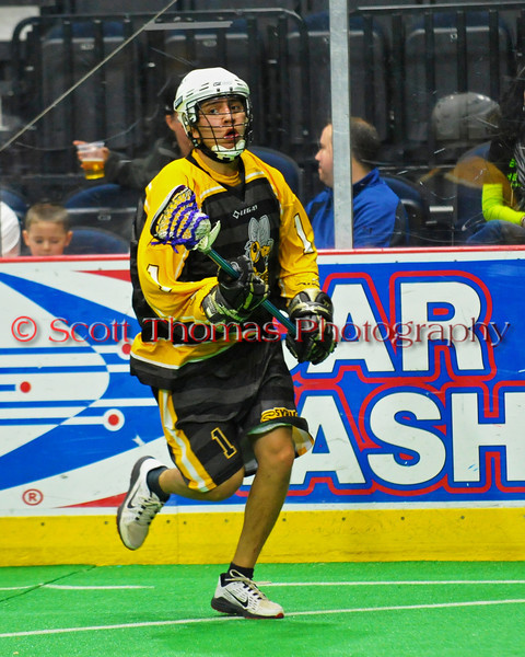 Syracuse Stingers Derek Bennet (1) carrying the ball against the NYC Lax All-Stars at the Onondaga County War Memorial in Syracuse, New York on Thursday, February 21, 2013.