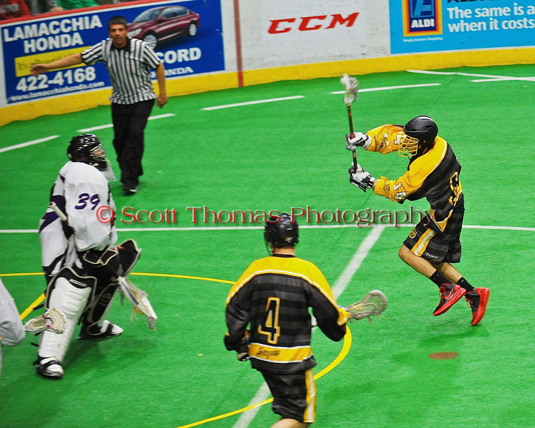 Syracuse Stingers Tyler Hill (14) driving for a goal against the NYC Lax All-Stars at the Onondaga County War Memorial in Syracuse, New York on Thursday, February 21, 2013.