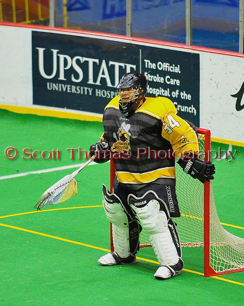Syracuse Stingers Spencer Lyons (34) guarding the net against the NYC Lax All-Stars at the Onondaga County War Memorial in Syracuse, New York on Thursday, February 21, 2013.
