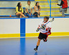 "Onondaga Redhawks Junior Bucktooth passes against the Newtown Golden Eagles in a Can-Am Senior ""B"" box lacrosse game at the Onondaga Nation Arena (Tsha'hon'nonyen'dakhwa') near Nedrow, New York on Saturday, May 12, 2012."