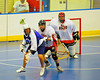 Onondaga Redhawks Luke Thompson (21) checks a Niagara Hawks player in Can-Am Senior B Box Lacrosse game held at the Onondaga Nation Arena near Nedrow, New York on Sunday, June 10, 2012. Redhawks won 11-4.