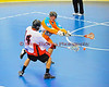 "Onondaga Redhawks Tyler Hill (14) shoots off his back feet to get it past Six Nations Slash defender Kenny Aaron (61) in round two of the Can-Am Senior ""B"" playoffs at the Onondaga Nation Arena near Nedrow, New York on Friday, July 27, 2012. Redhawks won 17 to 5."