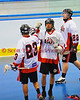 "Onondaga Redhawks Tyler Hill (14) is congratulated by teammate Tyler Church (23) after scoring the first goal against the Six Nations Slash in round two of the Can-Am Senior ""B"" playoffs at the Onondaga Nation Arena near Nedrow, New York on Friday, July 27, 2012. Redhawks won 17 to 5."