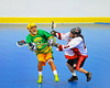 "Onondaga Redhawks Clayton Jones (11) cross checks a Newtown Golden Eagles player in the finals of the Can-Am Senior ""B"" Lacrosse league at the Onondaga Nation Arena near Nedrow, New York."