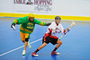"""Onondaga Redhawks David Stout (24) alludes a Newtown Golden Eagles defender in the finals of the Can-Am Senior """"B"""" Lacrosse league at the Onondaga Nation Arena near Nedrow, New York."""
