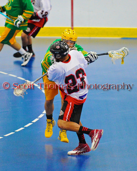 """Onondaga Redhawks Dwayne Porter (23) shoots and scores the first goal against the Newtown Golden Eagles in the finals of the Can-Am Senior """"B"""" Lacrosse league at the Onondaga Nation Arena near Nedrow, New York."""