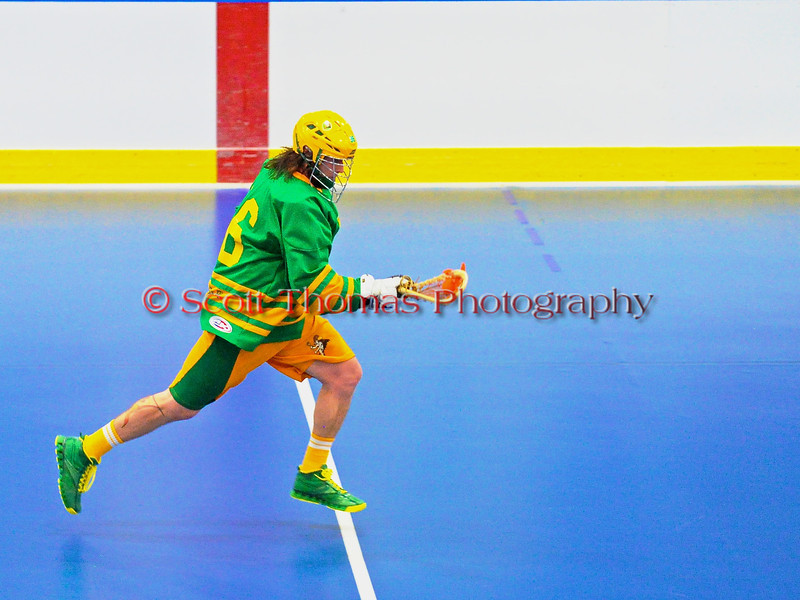 """Newtown Golden Eagles Ryan Maciaszek (96) carrys the ball against the Onondaga Redhawks in the finals of the Can-Am Senior """"B"""" Lacrosse league at the Onondaga Nation Arena near Nedrow, New York."""