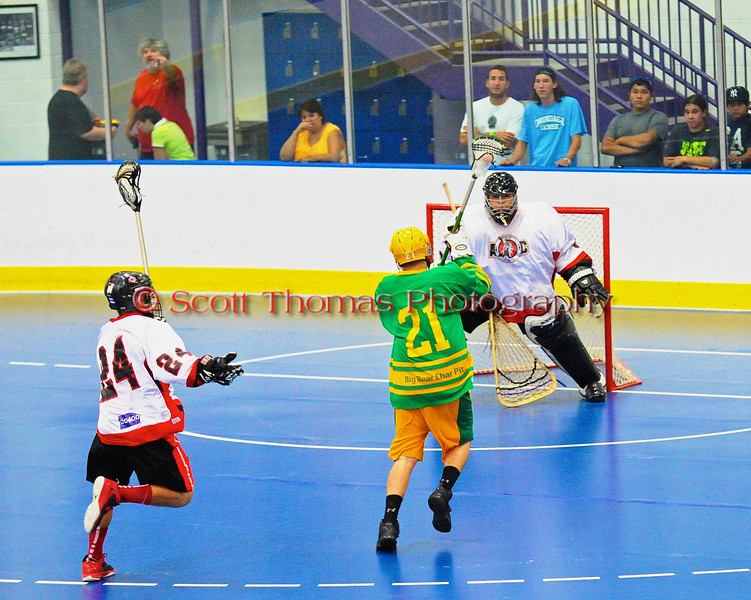 "Newtown Golden Eagles Morgan Montour (21) closes in on the Onondaga Redhawks goal in the finals of the Can-Am Senior ""B"" Lacrosse league at the Onondaga Nation Arena near Nedrow, New York."