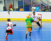 """Newtown Golden Eagles Morgan Montour (21) closes in on the Onondaga Redhawks goal in the finals of the Can-Am Senior """"B"""" Lacrosse league at the Onondaga Nation Arena near Nedrow, New York."""