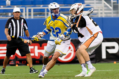#24 Mike Lazore Midfield Rochester Rattlers guards #22 Casey Powell Attack Florida Launch