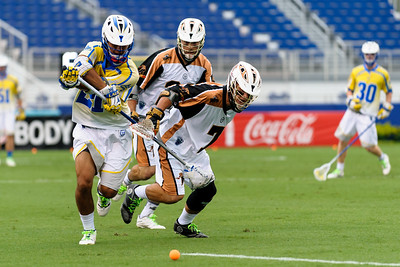 #21 Casey Ikeda Defense Florida Launch, checks the ball from #7 Kevin Rice Attack Rochester Rattlers