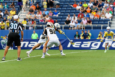 #65 Chris Mattes Midfield Florida Launch, wins the face off against #92 Mike Poppleton Midfield Rochester Rattlers