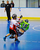 "Onondaga Redhawks players take out a Rochester Greywolves shooter in Can-Am Senior ""B"" Box Lacrosse at the Onondaga Nation Arena near Nedrow, New York on Saturday, April 28, 2012."