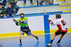 "Rochester Greywolves player passes to a teammate against the Onondaga Redhawks in Can-Am Senior ""B"" Box Lacrosse at the Onondaga Nation Arena near Nedrow, New York on Saturday, April 28, 2012."