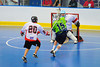 """Rochester Greywolves Dave Wood (15) is checked by  Onondaga Red Hawks Bill Empy (20) in Can-Am Senior """"B"""" Box Lacrosse playoff action at the Onondaga Nation Arena in Nedrow, New York on Friday, July 15, 2011.  Greywolves won 12-8."""