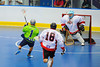 """Rochester Greywolves A.J. Laffin (1) moves in on  Onondaga Red Hawks goaltender Spencer Lyones (1) as Luke Thompson (18) gives chase in Can-Am Senior """"B"""" Box Lacrosse playoff action at the Onondaga Nation Arena in Nedrow, New York on Friday, July 15, 2011.  Greywolves won 12-8."""