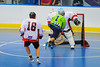 """Rochester Greywolves A.J. Laffin (1) shoots on  Onondaga Red Hawks goaltender Spencer Lyones (1) as Luke Thompson (18) gives chase in Can-Am Senior """"B"""" Box Lacrosse playoff action at the Onondaga Nation Arena in Nedrow, New York on Friday, July 15, 2011.  Greywolves won 12-8."""