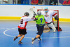 """Rochester Greywolves Josh Kacprzak (7) is checked by  Onondaga Red Hawks defender Luke Thompson (18) in Can-Am Senior """"B"""" Box Lacrosse playoff action at the Onondaga Nation Arena in Nedrow, New York on Friday, July 15, 2011.  Greywolves won 12-8."""