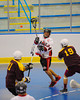 Onondaga Redhawks David Stout (24) makes a pass against Tuscarora Tomahawks at the Onondaga Nation Arena near Nedrow, New York on Saturday, June 23, 2012.