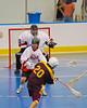Tuscarora Tomahawks Billy Farnham (20) slings a shot at the Onondaga Redhawks net in the Onondaga Nation Arena near Nedrow, New York on Saturday, June 23, 2012.
