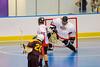 Onondaga Redhawks goalie Ross Bucktooth (30) fights off a shot by Tuscarora Tomahawks Billy Farnham (20) at the Onondaga Nation Arena near Nedrow, New York on Saturday, June 23, 2012.