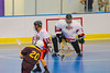 Onondaga Redhawks goalie Ross Bucktooth (30) makes a save against Tuscarora Tomahawks Billy Farnham (20) at the Onondaga Nation Arena near Nedrow, New York on Saturday, June 23, 2012.