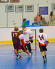 Tuscarora Tomahawks player is check by an Onondaga Redhawk at the Onondaga Nation Arena near Nedrow, New York on Saturday, June 23, 2012.
