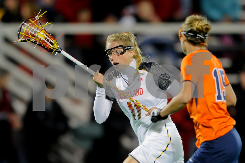 MAR 2, 2012 : Maryland's Midfielder Brooke Griffin (11) battles Virginia's Kelsey Gahan (15) during action between the Virginia Cavaliers and the University of Maryland Womens Lacrosse match up at the Field Hockey and Lacrosse Complex at the University of Maryland in College Park, MD. The Terrapins defeated the Cavaliers 12-9.