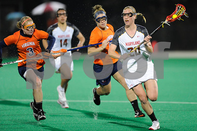 MAR 2, 2012 : Maryland Midfielder Beth Glaros (20) is chased by Virginia defenders during action between the Virginia Cavaliers and the University of Maryland Womens Lacrosse match up at the Field Hockey and Lacrosse Complex at the University of Maryland in College Park, MD. The Terrapins defeated the Cavaliers 12-9.