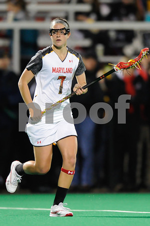 MAR 2, 2012 : Maryland Midfielder Katie Schwarzmann (7) advances the ball during action between the Virginia Cavaliers and the University of Maryland Womens Lacrosse match up at the Field Hockey and Lacrosse Complex at the University of Maryland in College Park, MD. The Terrapins defeated the Cavaliers 12-9.