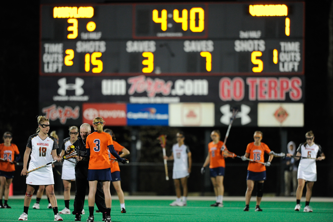 Caption Error MAR 2, 2012 : Virginia's Josie Owen (3) faces off with Maryland's Karri Ellen Johnson (18) during action between the Virginia Cavaliers and the University of Maryland Womens Lacrosse match up at the Field Hockey and Lacrosse Complex at the University of Maryland in College Park, MD. The Terrapins defeated the Cavaliers 12-9.