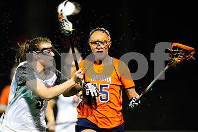 MAR 2, 2012 : Virginia Midfielder Kelsey Gahan (15) battles Maryland's Kelly McPartland (6) while advancing the ball down the field during action between the Virginia Cavaliers and the University of Maryland Womens Lacrosse match up at the Field Hockey and Lacrosse Complex at the University of Maryland in College Park, MD. The Terrapins defeated the Cavaliers 12-9.
