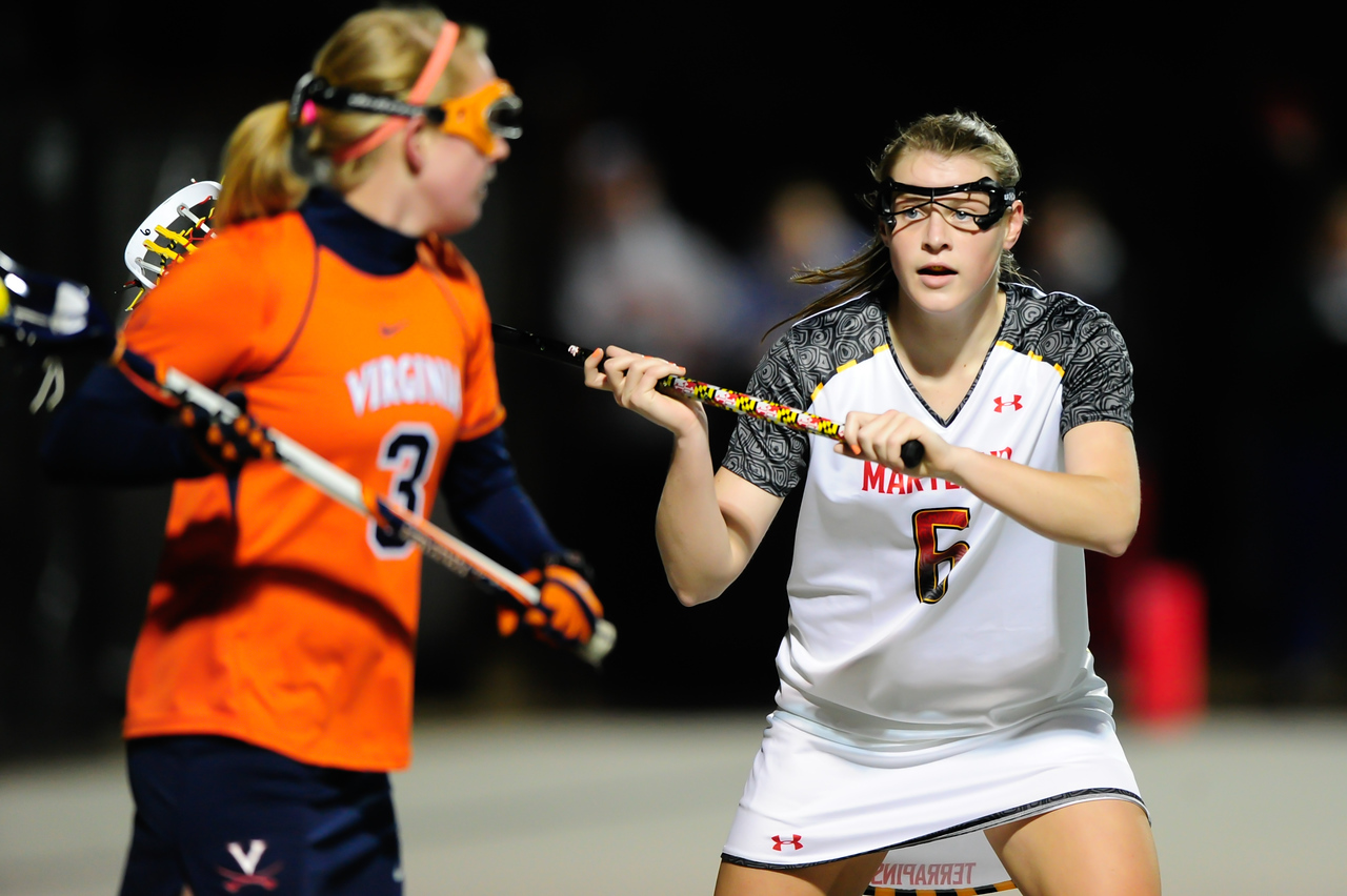 MAR 2, 2012 : Maryland Midfielder Kelly McPartland (6) battles Virginia Attacker Josie Owen (3) during action between the Virginia Cavaliers and the University of Maryland Womens Lacrosse match up at the Field Hockey and Lacrosse Complex at the University of Maryland in College Park, MD. The Terrapins defeated the Cavaliers 12-9.