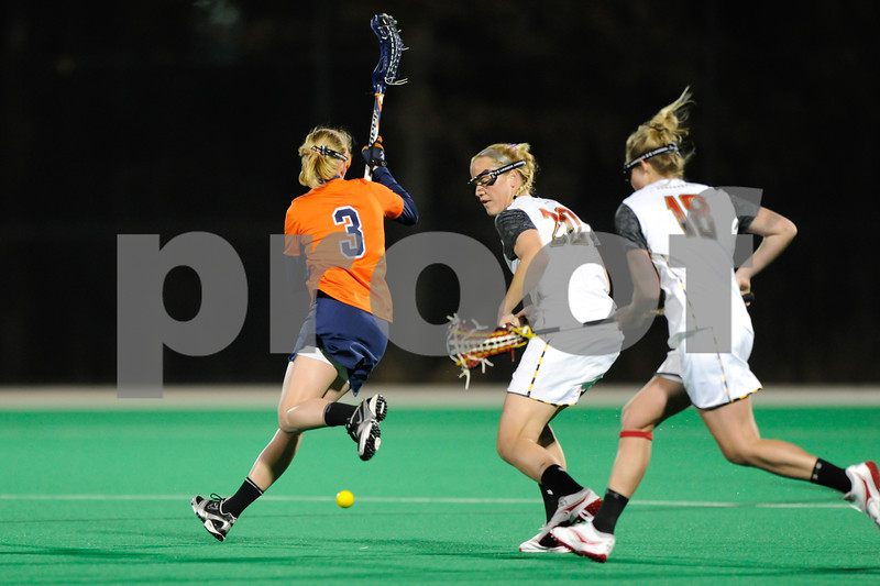 MAR 2, 2012 : Virginia Attacker Josie Owen (3) loses the ball while Maryland's Beth Glaros (20) and Karri Ellen Johnson (18) scoop it up during action between the Virginia Cavaliers and the University of Maryland Womens Lacrosse match up at the Field Hockey and Lacrosse Complex at the University of Maryland in College Park, MD. The Terrapins defeated the Cavaliers 12-9.